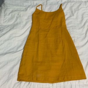 mustard color bodyvon dress